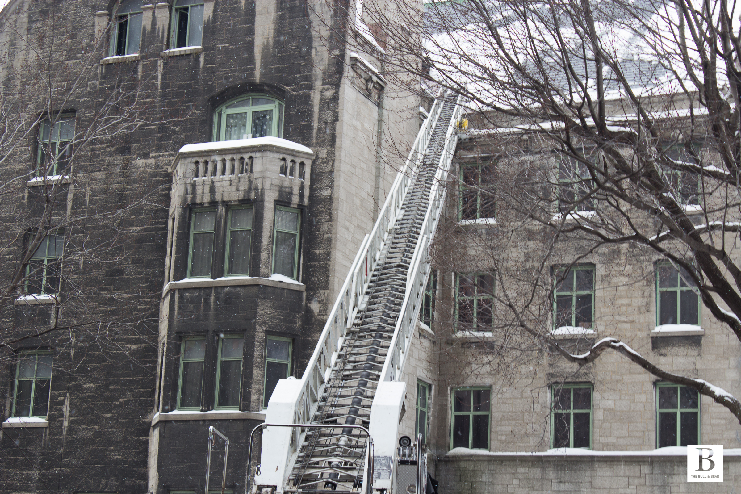 A ladder sits against the side of Royal Victoria College on Sherbrooke.