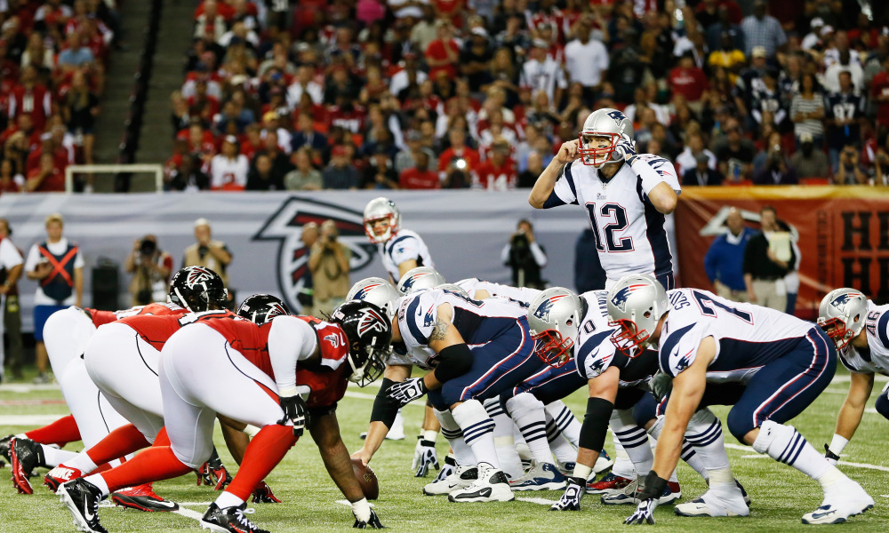ATLANTA, GA - SEPTEMBER 29:  Tom Brady #12 of the New England Patriots calls a play against the Atlanta Falcons during the game at Georgia Dome on September 29, 2013 in Atlanta, Georgia.  (Photo by Kevin C. Cox/Getty Images)